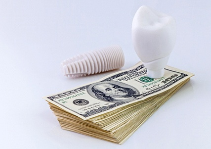 Middle-aged couple smiling outside wearing grey