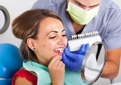 woman getting veneers in Saginaw