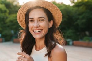 Woman showing off her healthy smile while outside